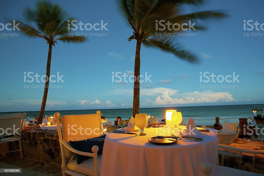 Romantic dining by the beach stock photo