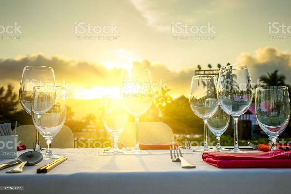 Romantic Dinner at beach in sunset stock photo