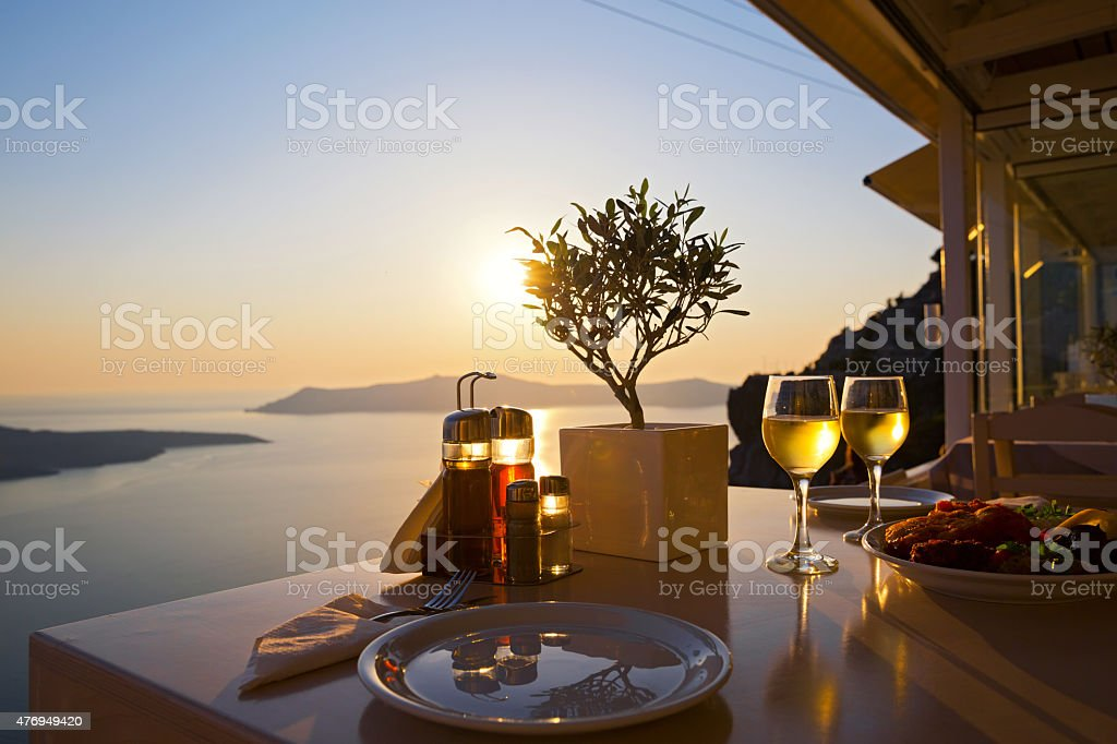 Romantic dinner for two at sunset stock photo