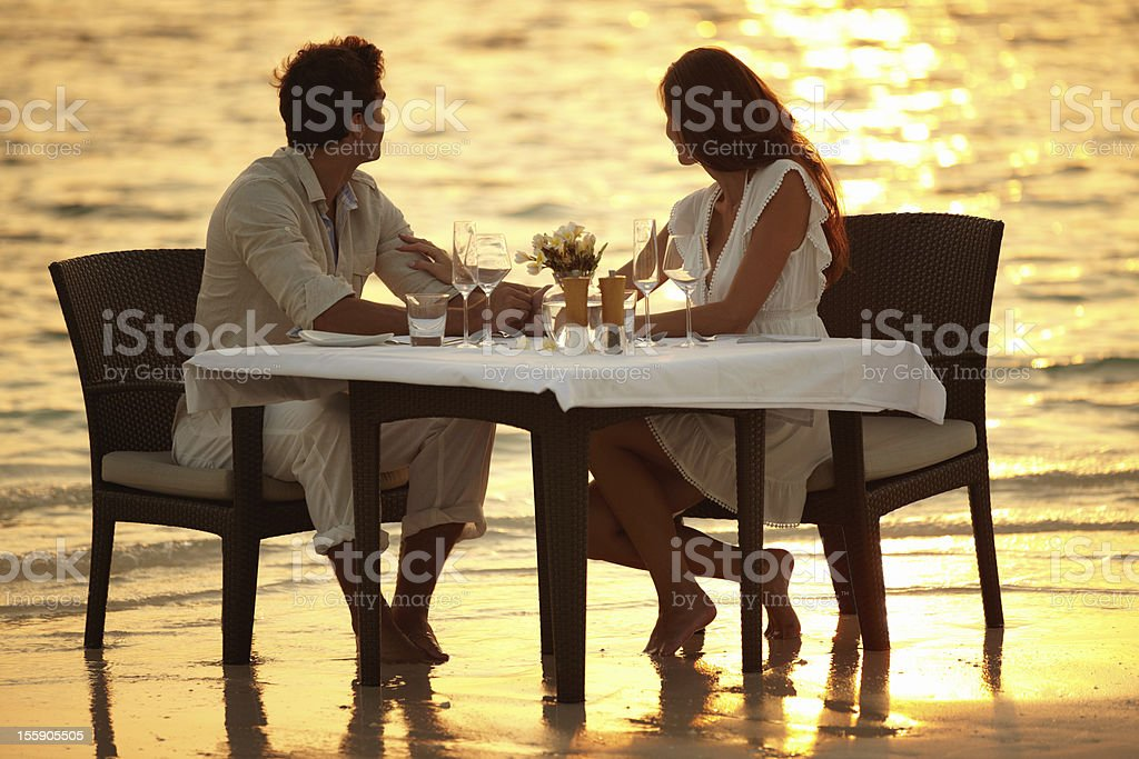 Romantic dinner in the waves stock photo