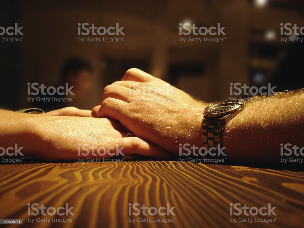 Romantic dinner - Love couple holding hands royalty-free stock photo