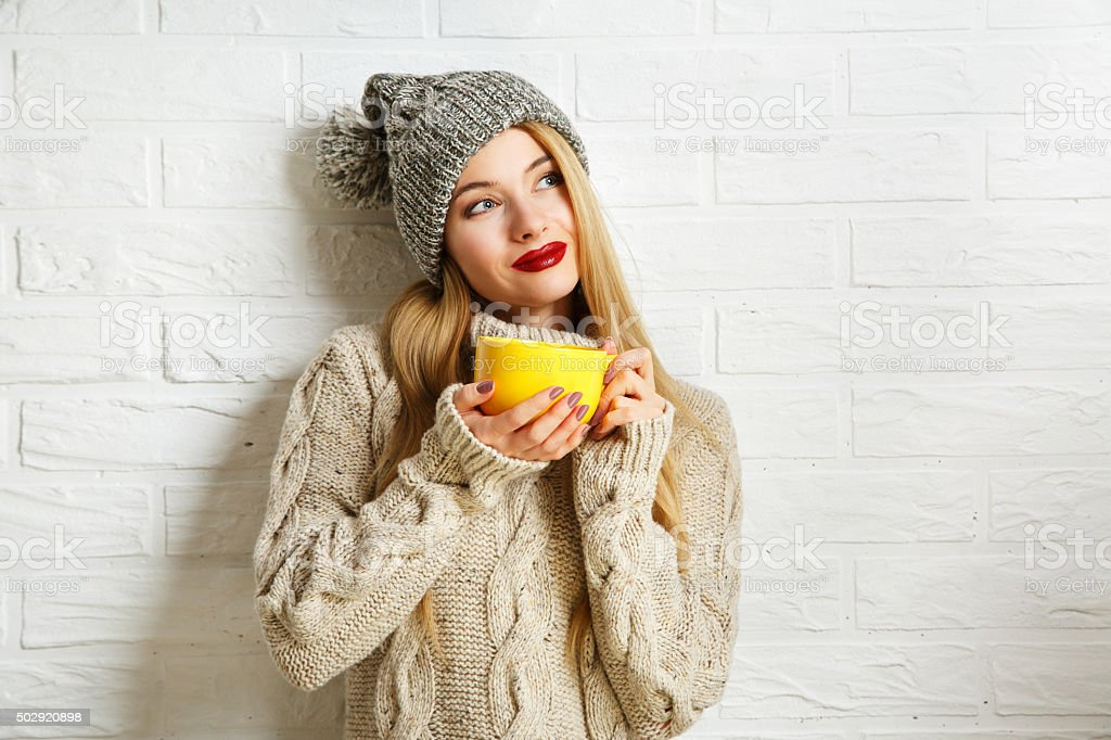 Romantic Dreaming Winter Hipster Girl with a Mug stock photo