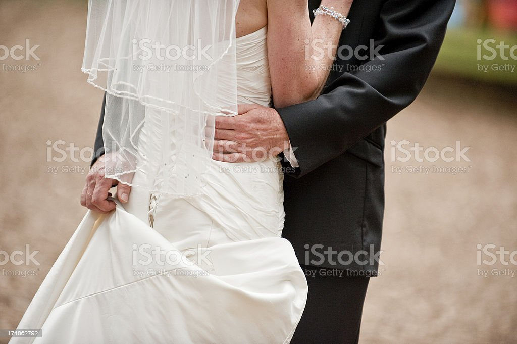 Romantic Embrace of Bride and Groom Outdoors on Wedding Day royalty-free stock photo