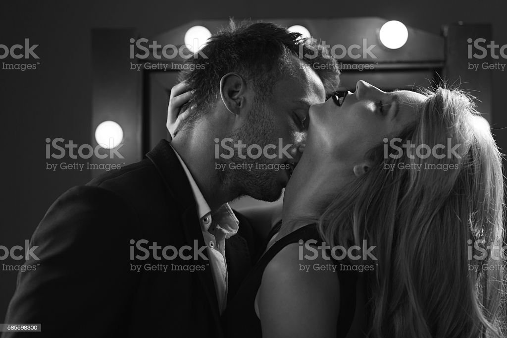 Romantic excited couple kissing stock photo