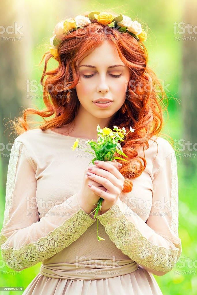 Romantic girl with wild flowers stock photo