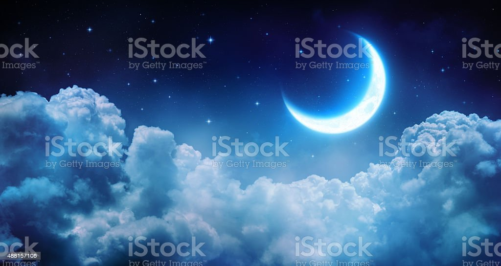 romantic half moon on the clouds stock photo