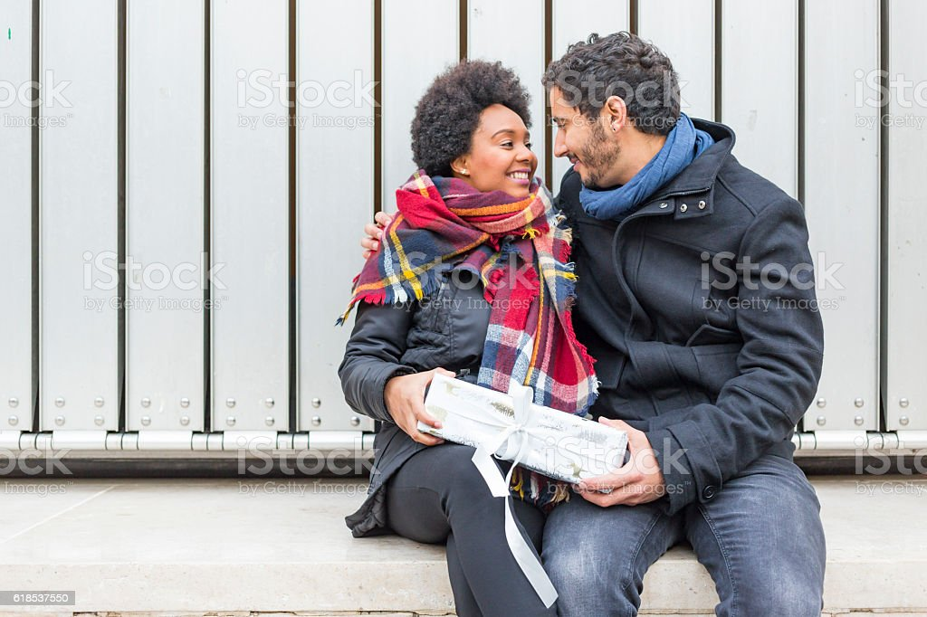Romantic Hipster Couple Giving Christmas Gifts stock photo