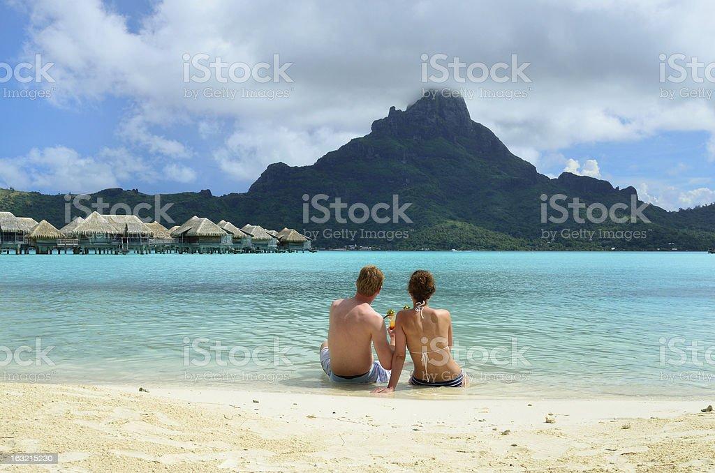 Romantic honeymoon couple near Tahiti stock photo