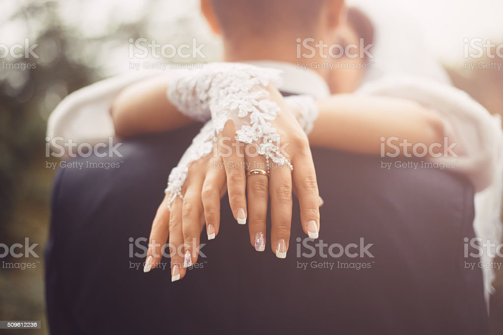 Romantic hugs of newlyweds stock photo