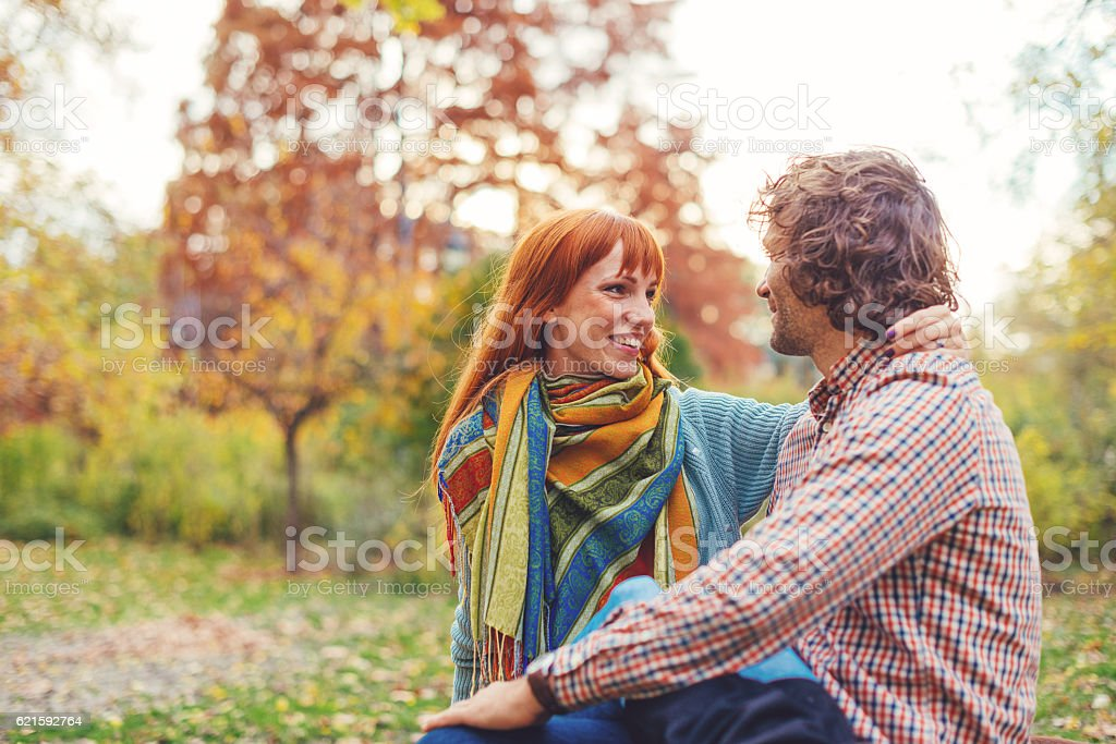 Romantic image of loving couple in park in autumn stock photo