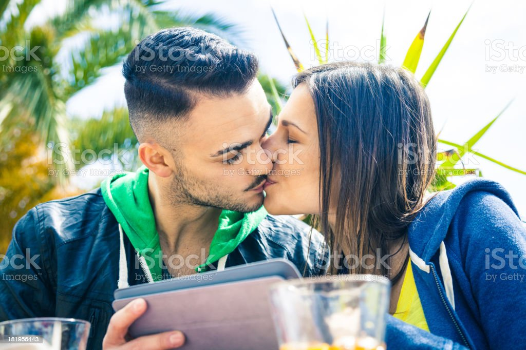 Romantic kiss and cocktails royalty-free stock photo