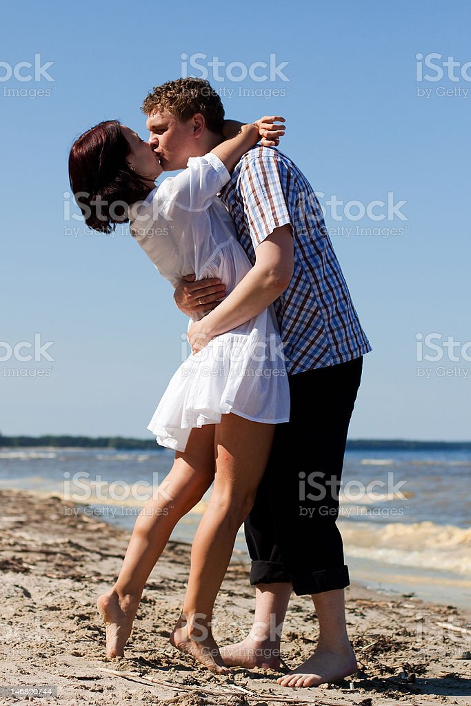 Romantic Kiss on the Beach royalty-free stock photo
