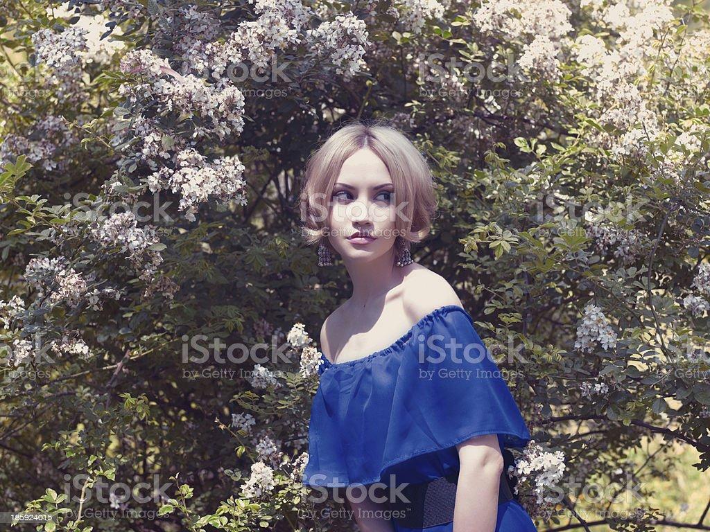 Romantic lady in the garden stock photo