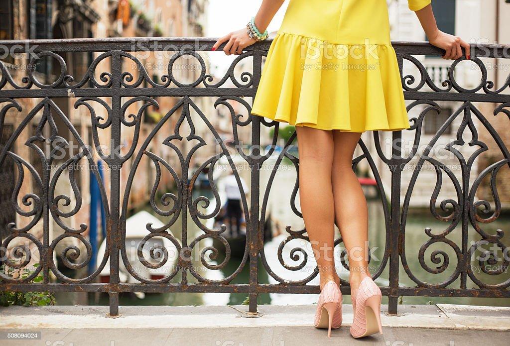 Romantic lady standing on the bridge stock photo