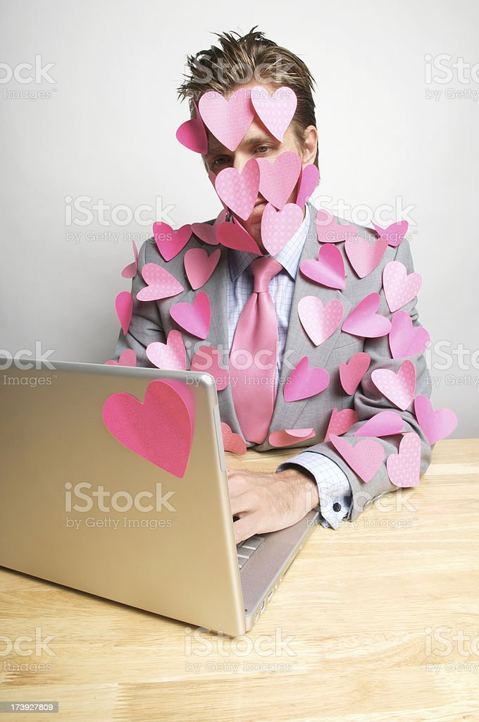 Romantic Lover Businessman Office Worker Covered in Pink Hearts royalty-free stock photo