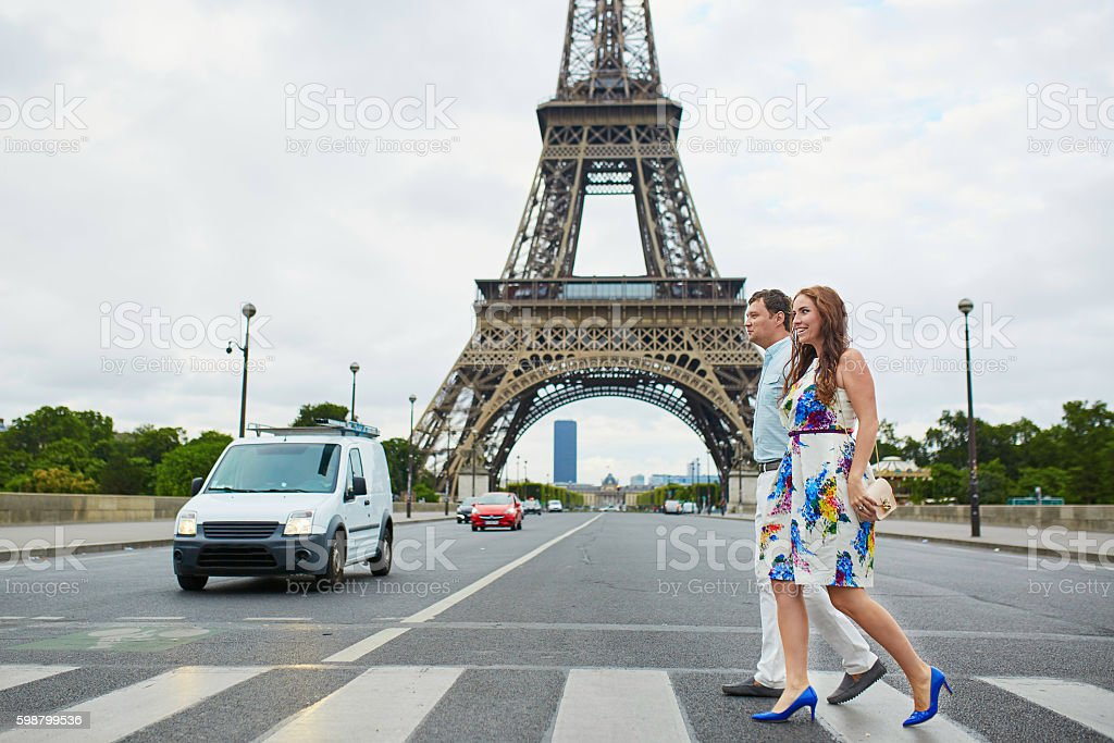 Romantic loving couple having a date near the Eiffel tower stock photo