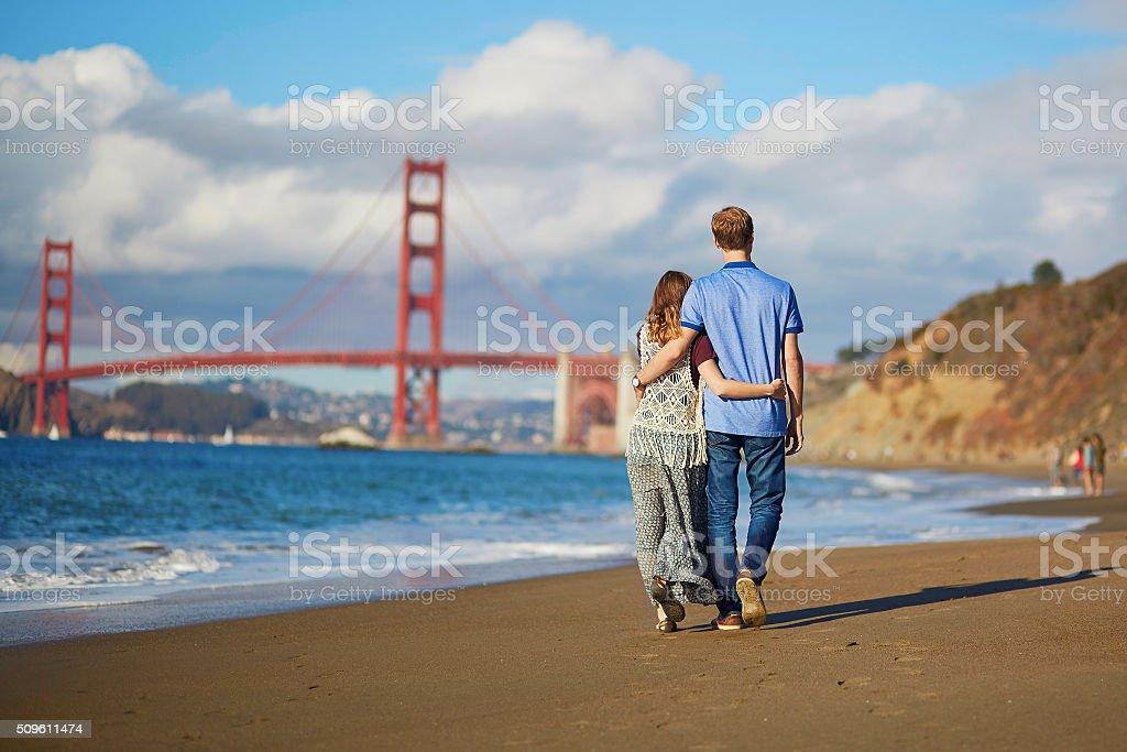 Romantic loving couple on Baker beach in San Francisco stock photo