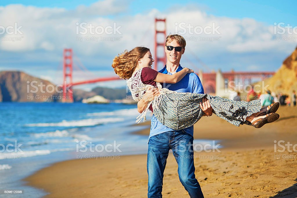 Romantic loving couple on Baker beach in San Francisco stock photo