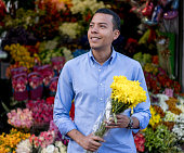 Romantic man buying flowers at a stand