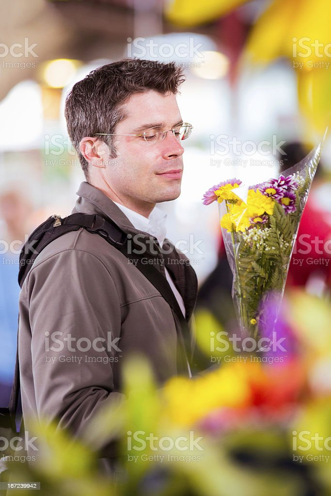 Romantic man shopping flowers at local market royalty-free stock photo