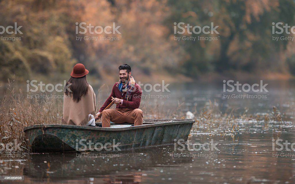 Romantic man taking his girlfriend on a boat ride. stock photo