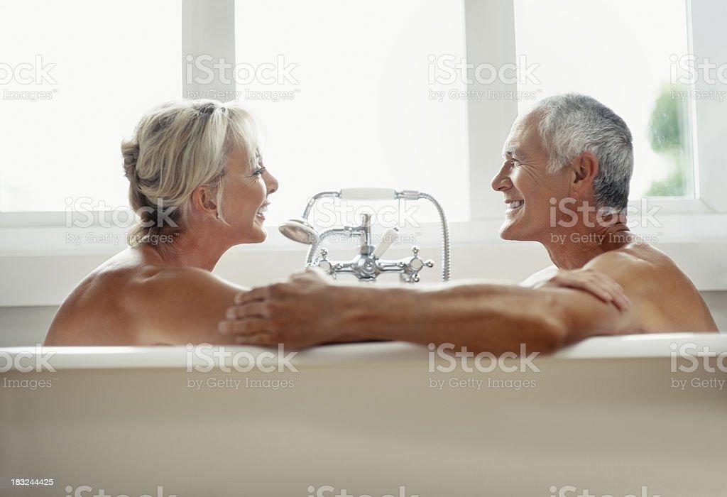 Romantic mature couple enjoying and having fun in bathtub royalty-free stock photo
