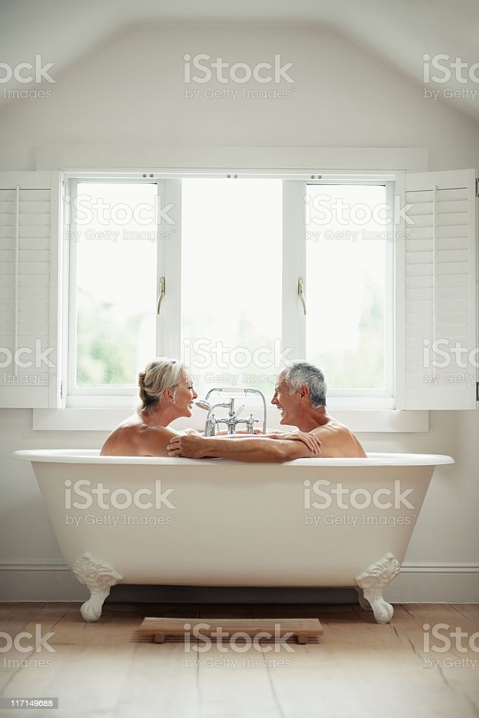 Romantic, mature couple having fun in a bathtub royalty-free stock photo