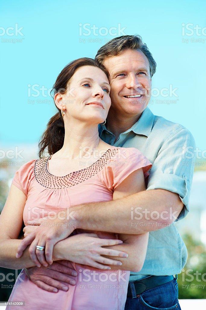 Romantic mature couple hugging eachother stock photo