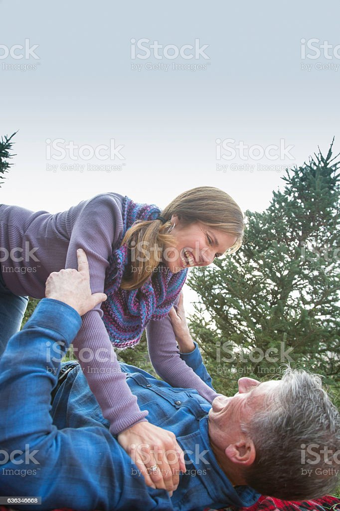 Romantic Mature Couple Playfully Wrestling stock photo