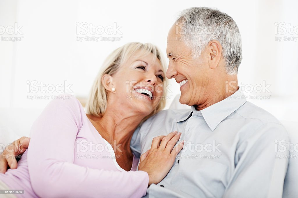 Romantic mature couple smiling while looking at each other royalty-free stock photo