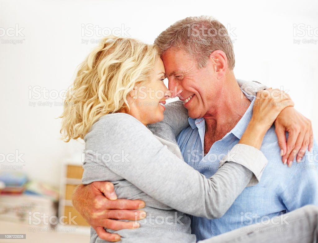 Romantic mature couple spending time together at home royalty-free stock photo