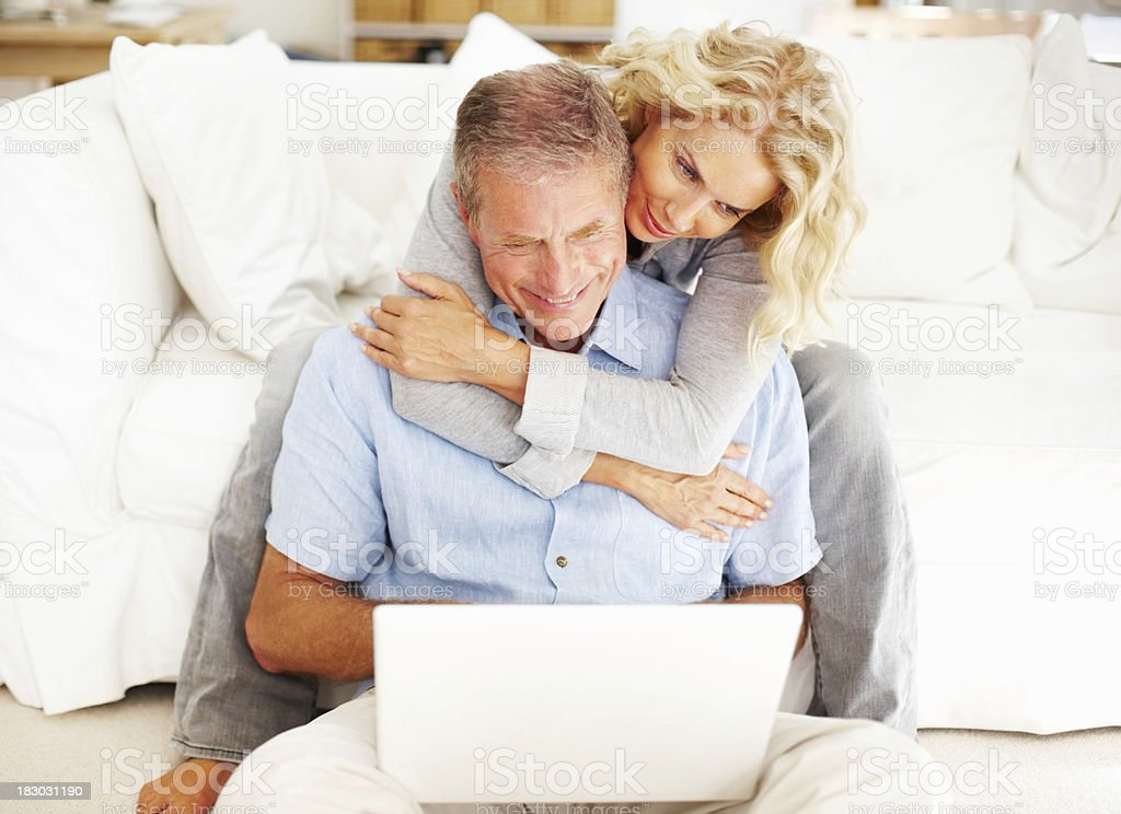Romantic mature couple using laptop at home royalty-free stock photo