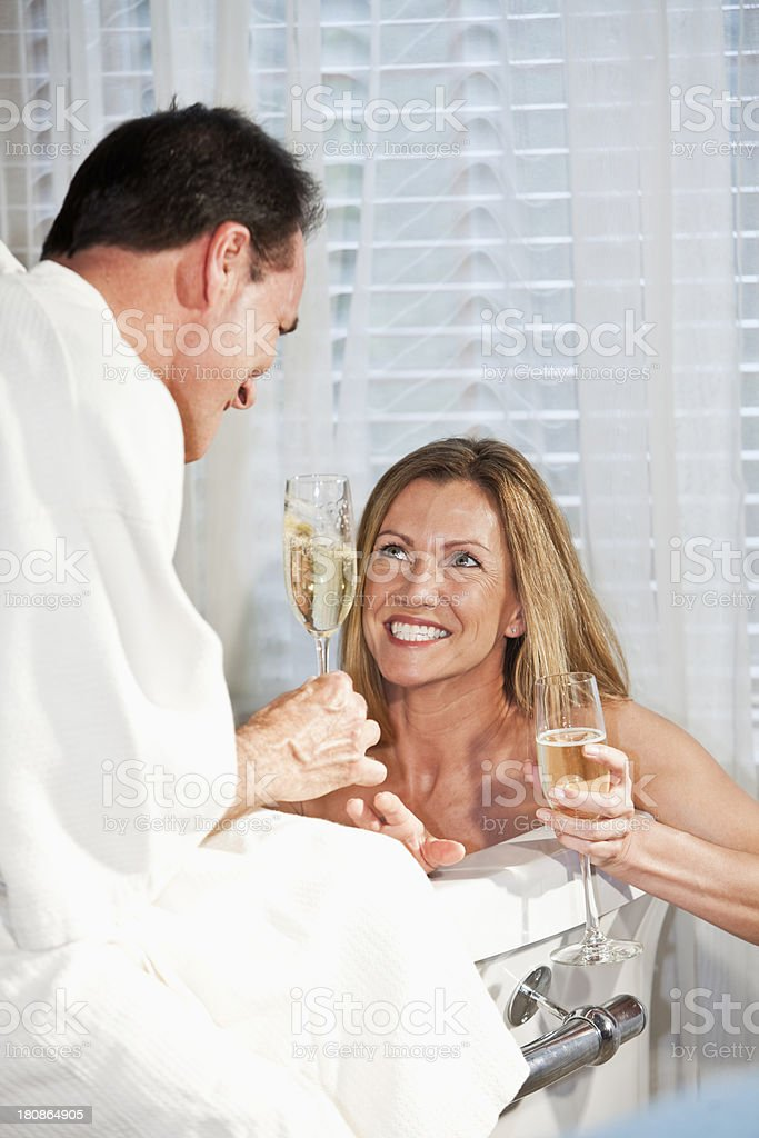 Romantic mature couple with champagne in bathtub royalty-free stock photo