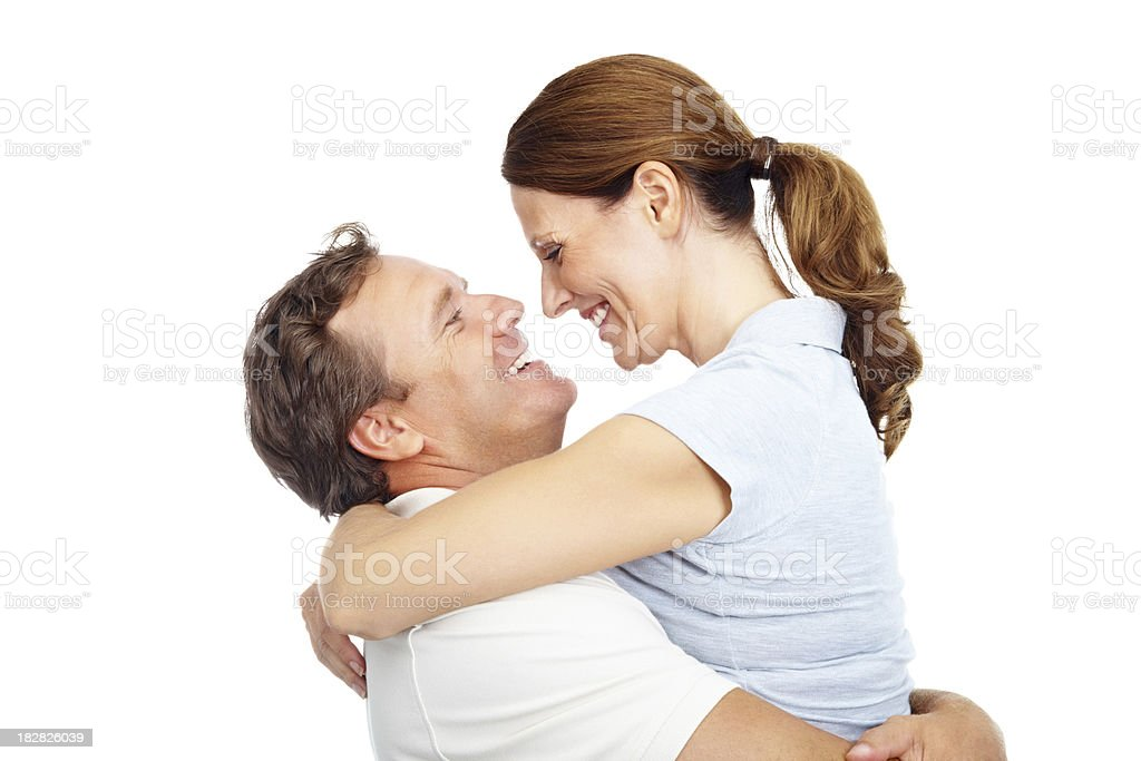 Romantic mature man lifting wife against white background royalty-free stock photo