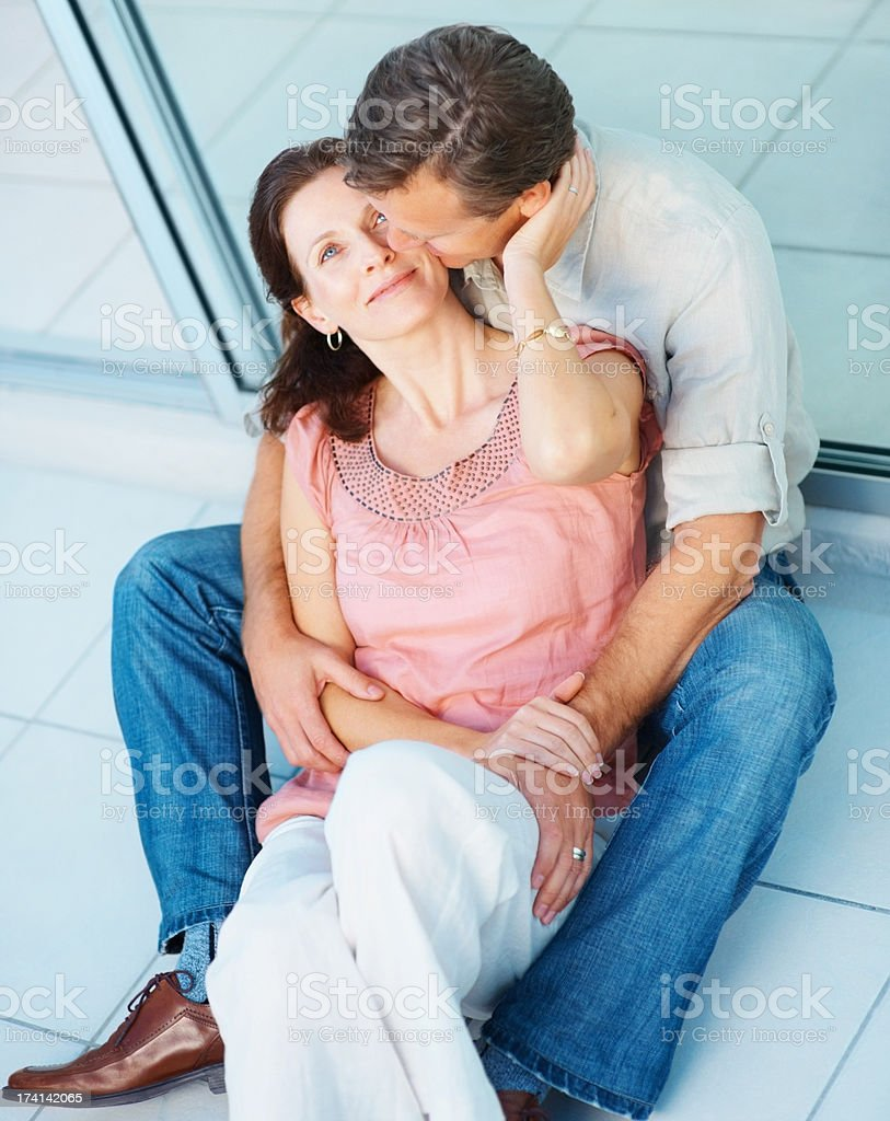 Romantic middle aged couple sitting together stock photo