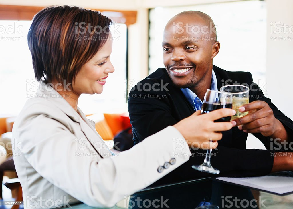 Romantic moment as stylish couple toast each other royalty-free stock photo