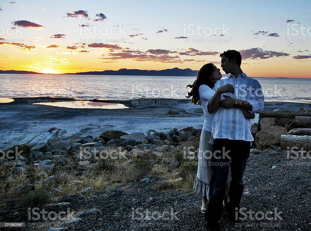 Romantic Moment During Sunset at a Lake stock photo