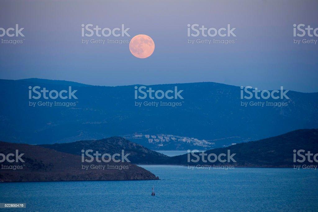 romantic moonlit night over the sea stock photo