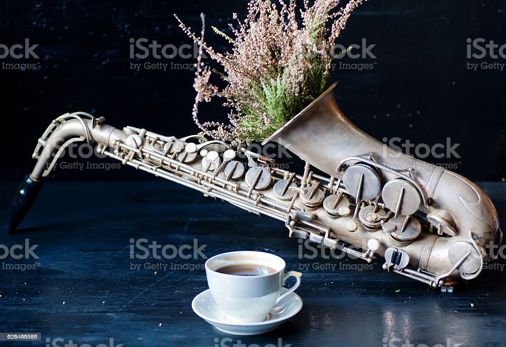 Romantic morning with coffee cup and saxophone stock photo