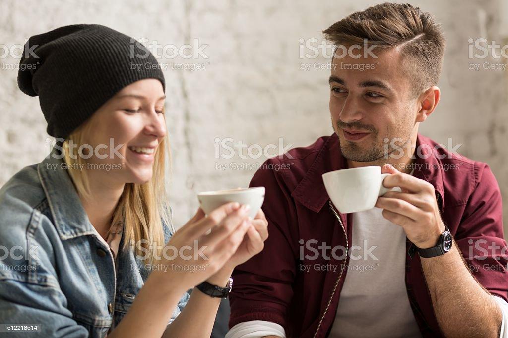 Romantic pair drinking coffee stock photo