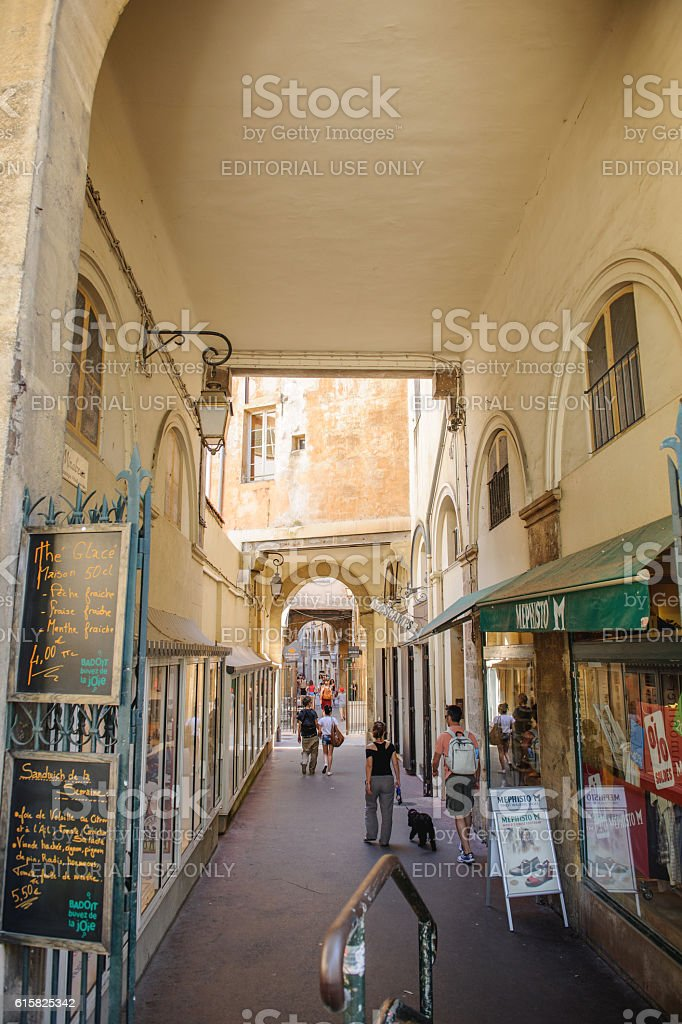 Romantic passage in Place de Verdun central city of Aix stock photo