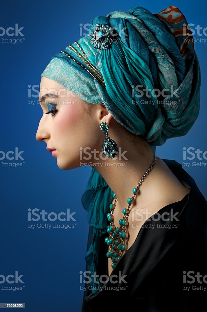 Romantic portrait of young woman in a turquoise turban stock photo