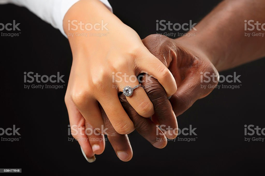 Romantic proposing  Close up man  holding woman's hand  Engagement ring stock photo