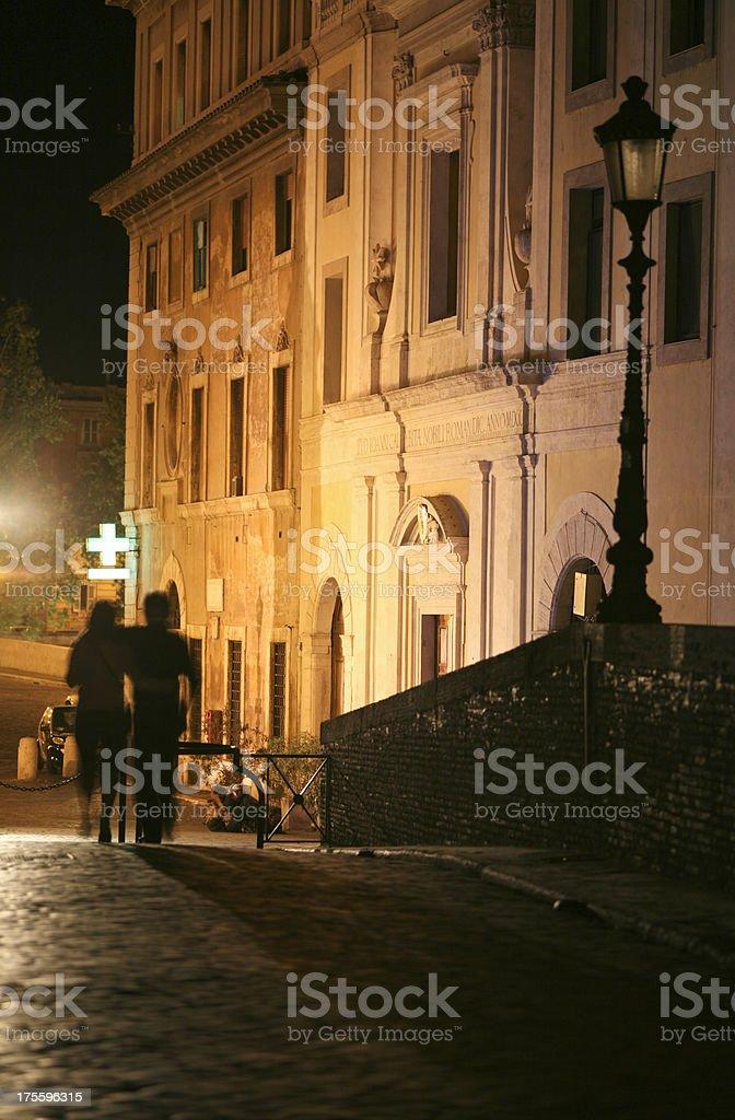 romantic rome, latenight couple in trastevere royalty-free stock photo