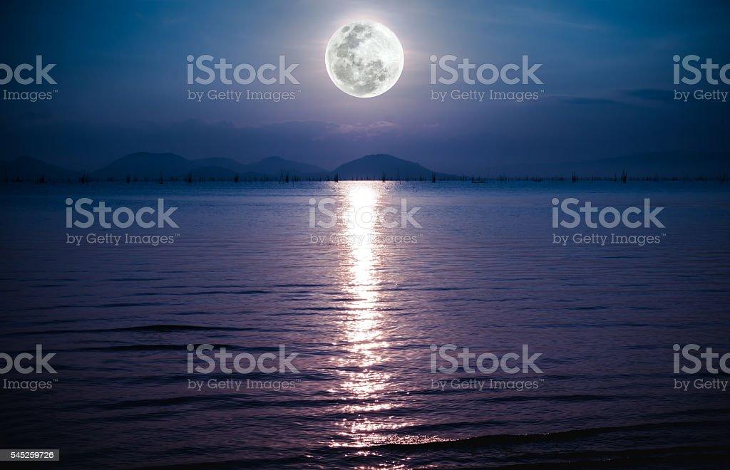 Romantic scenic with full moon on sea to night. stock photo
