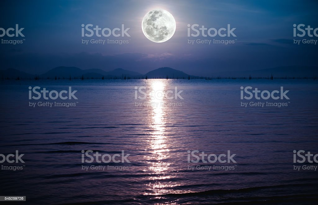 Romantic scenic with full moon on sea to night. stock photo
