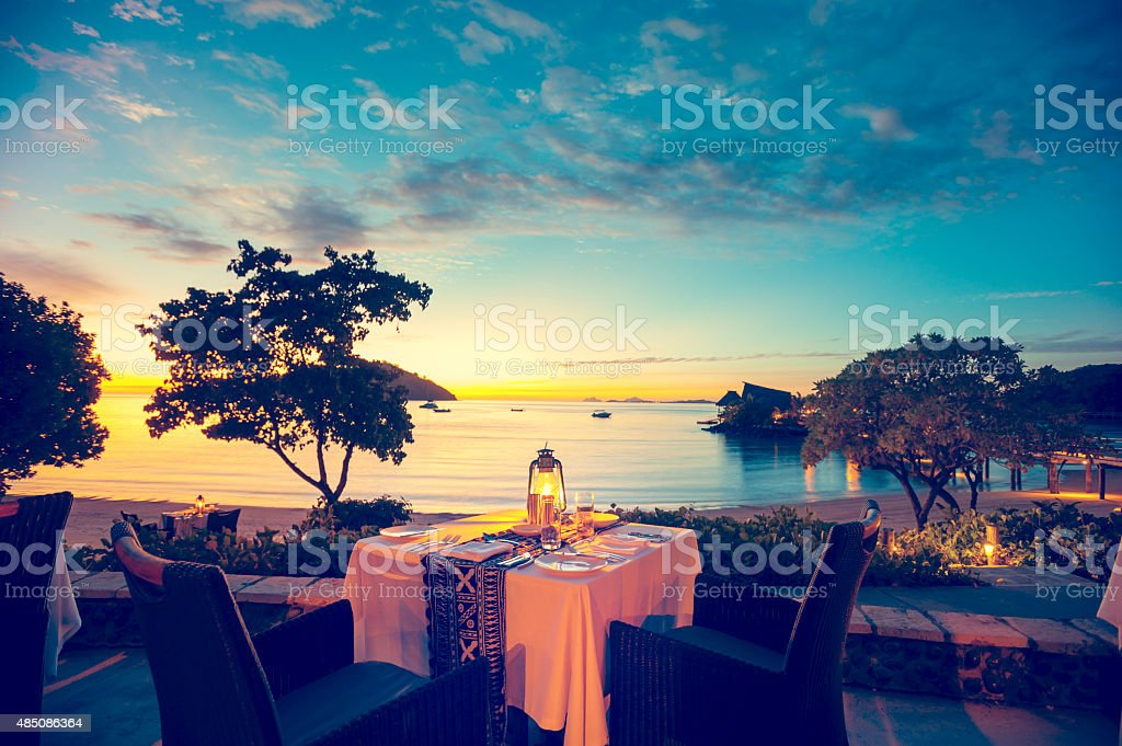 Romantic seaside restaurant at sunset stock photo