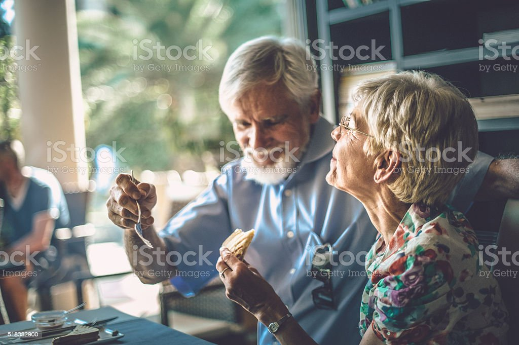Romantic Senior Couple Enjoying their Breakfeast in Patisserie stock photo