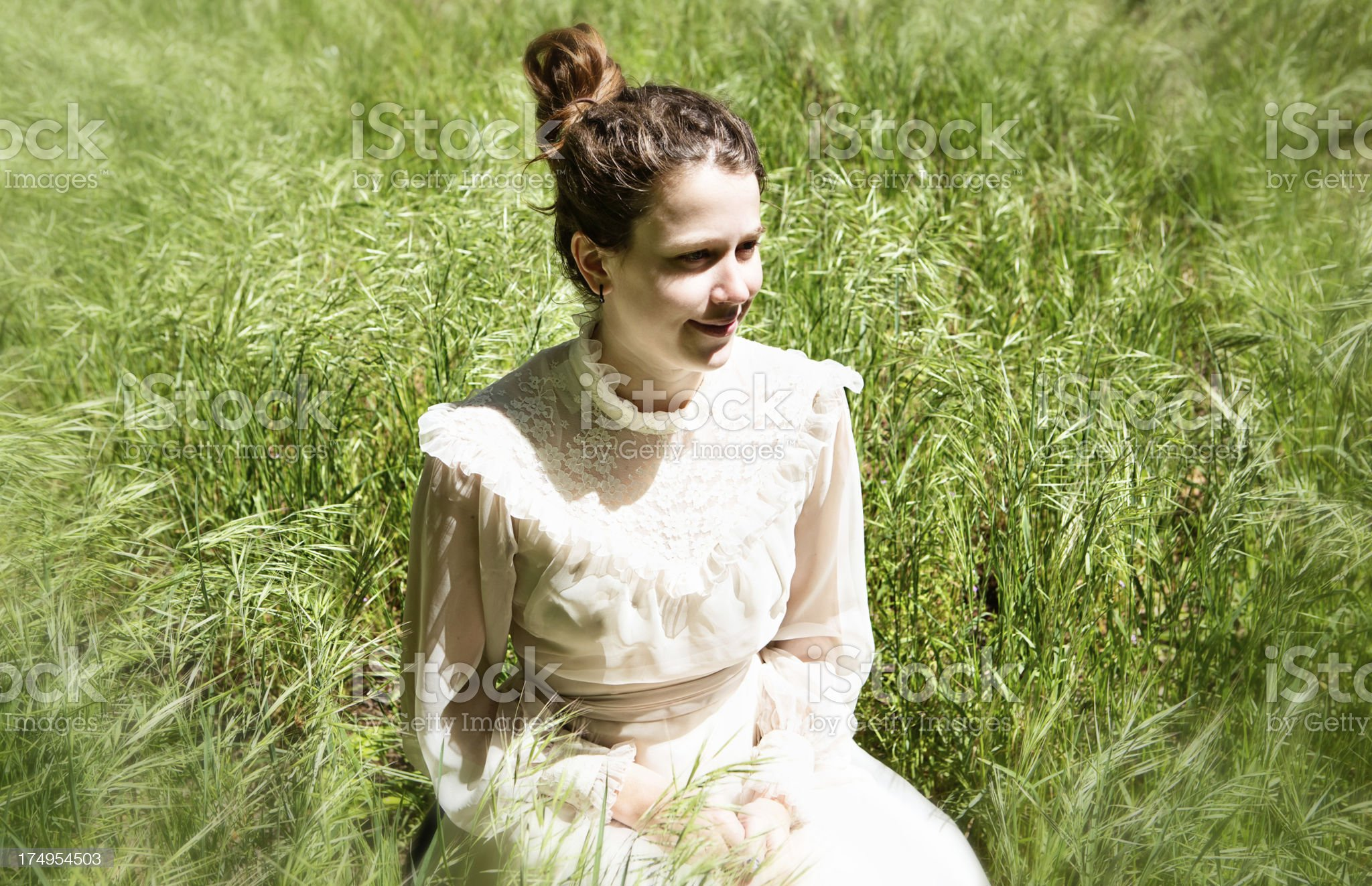 Romantic soft-focus portrait of old-fashioned young woman smiling royalty-free stock photo