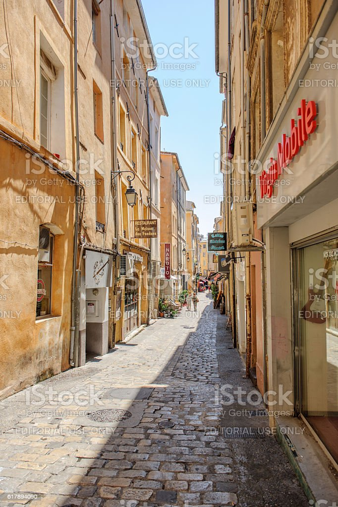 Romantic street in Aix-En-Provence, South of France with pedestrian stock photo